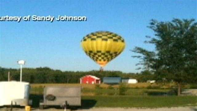 A newly engaged couple and a hot-air balloon pilot are injured after the balloon crashes into utility wires.