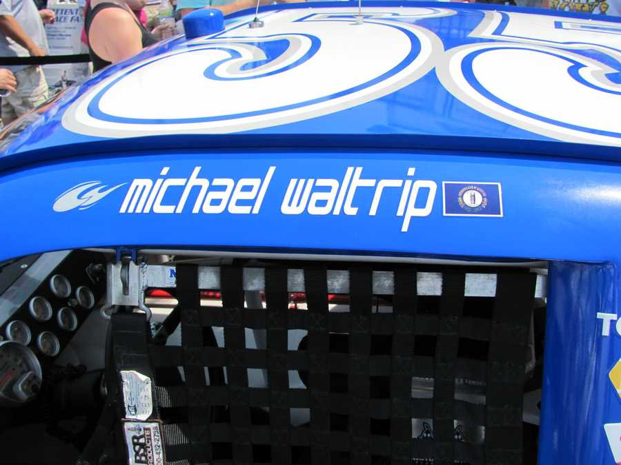 A replica of the No. 55 car driven by Michael Waltrip honors the 2012 University of Kentucky national championship basketball team.