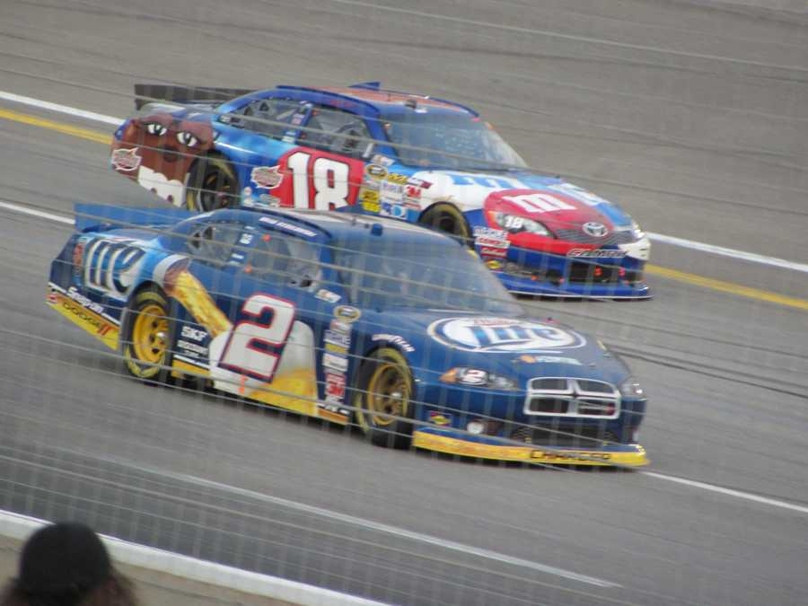 Brad Keselowski (No. 2) and Kyle Busch (No. 18) dueling for position.