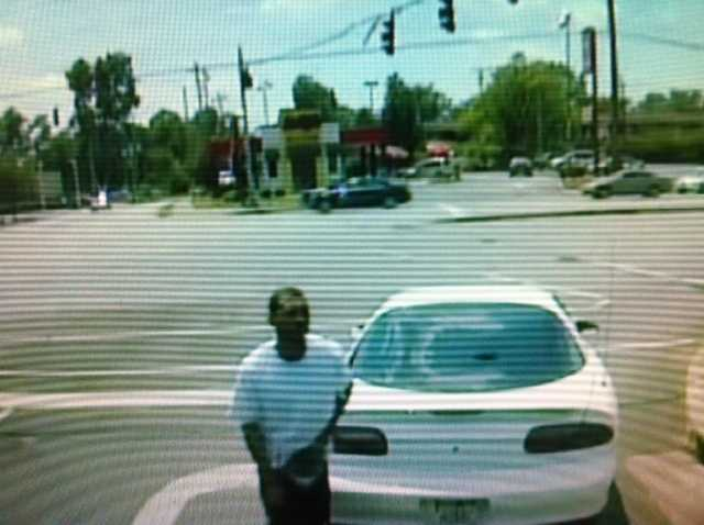 Police also released pictures of two of those persons of interest getting into a white car.