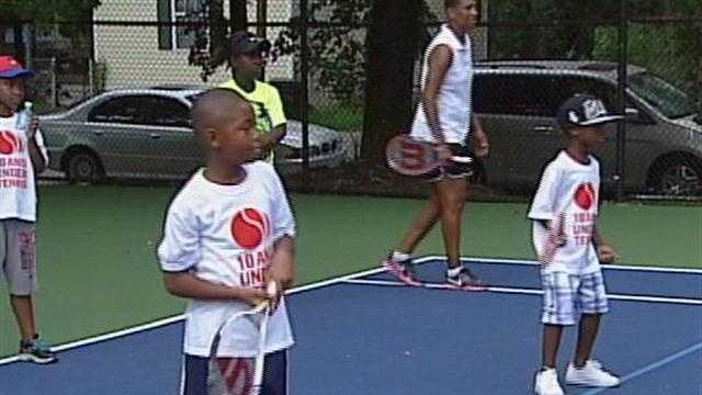 Community leaders gather at a park in west Louisville on Tuesday morning to dedicate five new tennis courts.