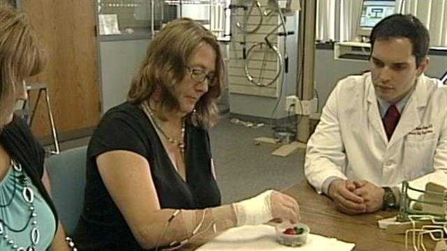A mail carrier is recovering after nearly losing her hand when she was attacked by a pit bull.