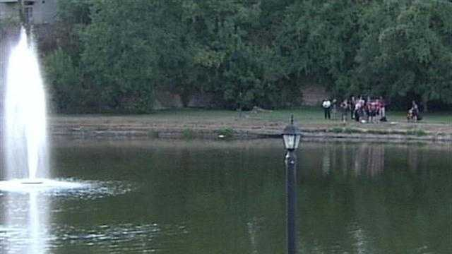 Louisville Metro Police investigate after a man's body is pulled from an area lake.
