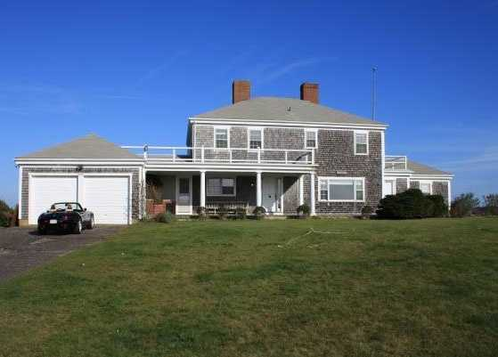 The harborfront listing on Dunham Road has nine rooms and four bathrooms.