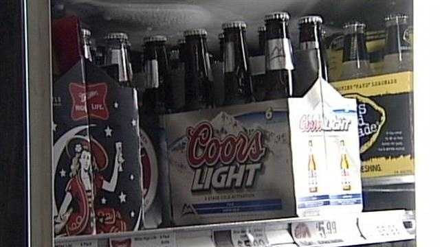 A federal judge strikes down Kentucky's seven-decade-old ban on grocery stores, gas stations and other retailers selling wine and liquor.