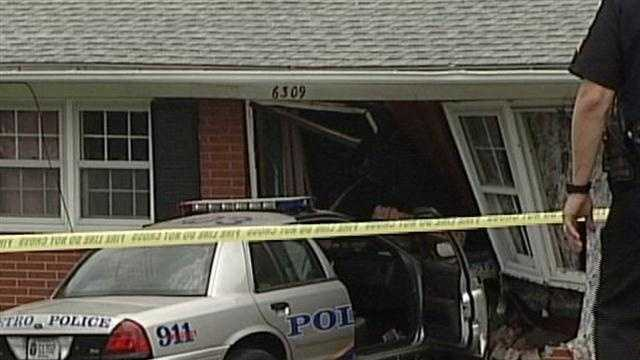 A police car has crashed into a home in the 6200 block of Outer Loop near Zenith Way.