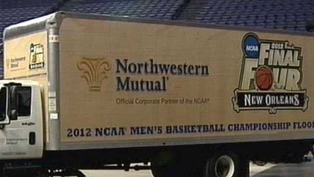 The University of Kentucky is presented with the court that the men's basketball team won the 2012 NCAA championship on.
