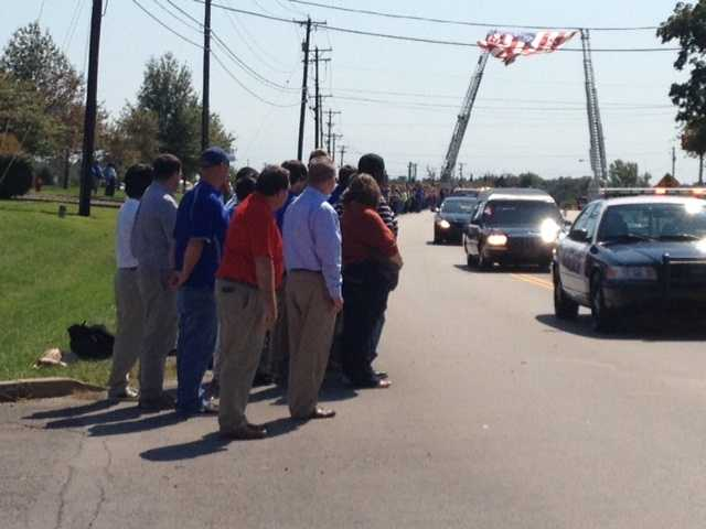 Supporters lined the streets Thursday as Officer Mark Tulbee's body was moved from a private visitation to the public memorial.