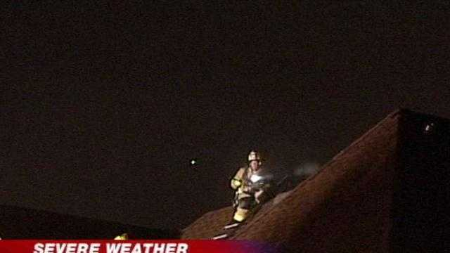 Firefighters say a house caught fire after a lightning strike