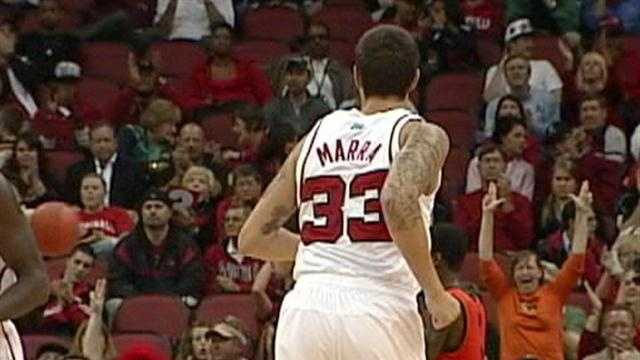 University of Louisville basketball guard Mike Marra re-injured his left ACL Friday, ending his playing career.