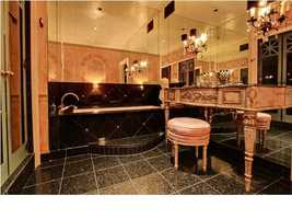 This is not a bathroom. It's an adorned sanctuary of cleanliness.