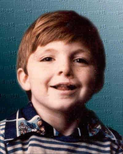 Kelly Hollan was 10 years old and playing in the yard in front of his house in Mousie, KY, at the time of his disappearance, on February 12, 1982. Kelly has a speech impediment and a scar between his nose and upper lip as seen in the picture.