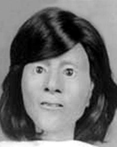 "On July 4, 1984, the remains of an unidentified female were located along the northbound lane of I-65, approximately 2-1/2 miles south of Bowling Green, Kentucky. The decedent was estimated to be between 14 and 20 years of age. She was between 4'08"" and 5'-00"" tall and likely weighed between 90 and 115 pounds. She was wearing a long-sleeve multi-colored pullover blouse and red corduroy Levi pants. She had a healed lesion on the rear of her skull and a scar on her right elbow. She also had dental work completed within 4 to 5 years of her death. She was estimated to have been deceased for 12 to 20 months prior to the discovery of her remains on July 24, 1984."