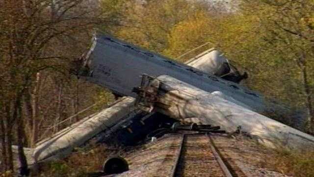 The first camera was allowed up-close at the scene of Monday's train derailment on Friday.
