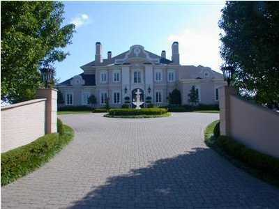 Extravagant driveway sets the tone for this estate.