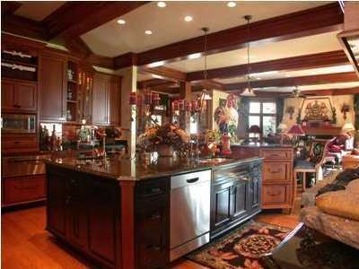 Commercial kitchen consists of custom cherry cabinets & granite countertops.