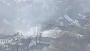 Fire crews battled a blaze at the scene of a standoff on Wednesday afternoon.