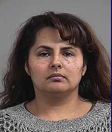 Evelia Macias-Farias: Charged with Trafficking in Marijuana > 5 lbs. enhanced by a firearm, and Engaging in an Organized Criminal Syndicate. (Read more)