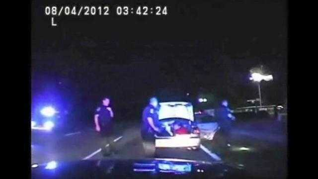 Raw dashcam video of a kidnapped clerk found in the trunk of his own car.