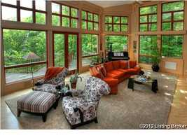 This view of the living room shows all the beautiful windows this room has to offer.