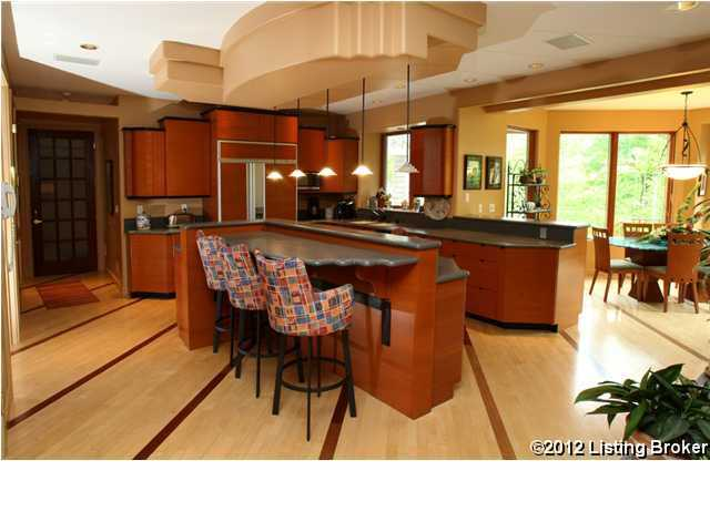 Modern kitchen also has a dining bar wide enough for 3 people.