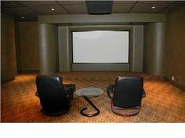Entertainment room features a large projector screen.