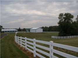 This 299 acre horse farm is the complete estate with its 4 rail PVC white fenced paddocks, run-ins, turn-key training/breeding facility with 13+ stalls and 72'x225' indoor lighted arena.