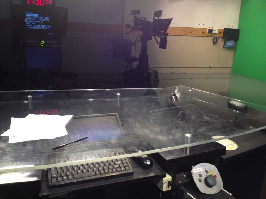 Under the news desk