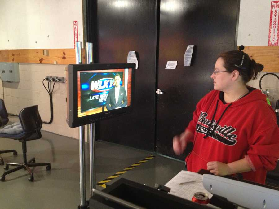 Floor director Ally checks out the shot as Eric begins the newscast