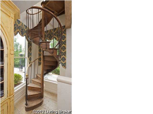 A whimsical, wooden, winding staircase.