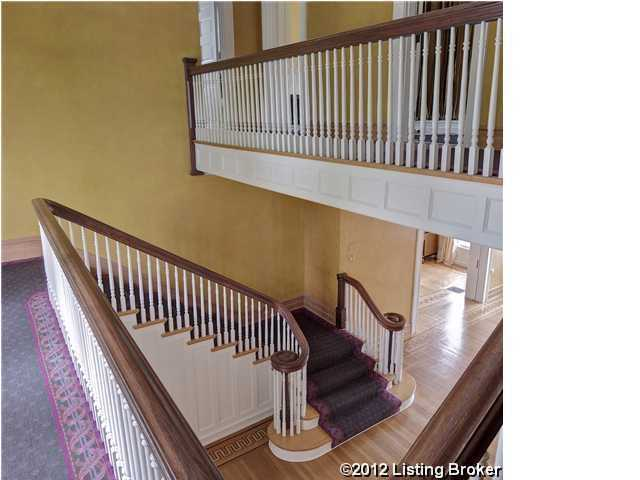 Main staircase of the home, featuring a wooden balcony.