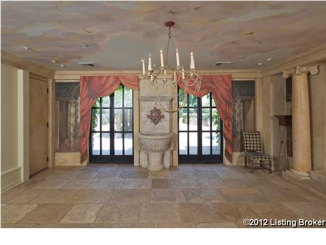 A beautiful dining space, featuring an elegant, hand-painted mural.