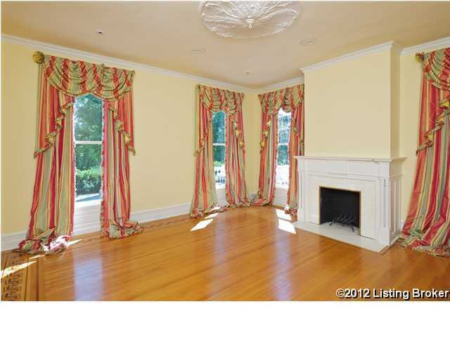 This photo offers an alternate view of the room featuring a quaint fireplace. This space would make a beautiful living room.