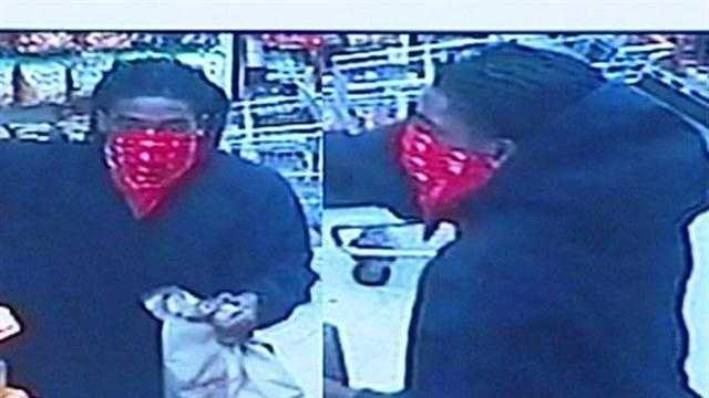 Police say they've solved a string of armed business robberies with the arrests of two men.