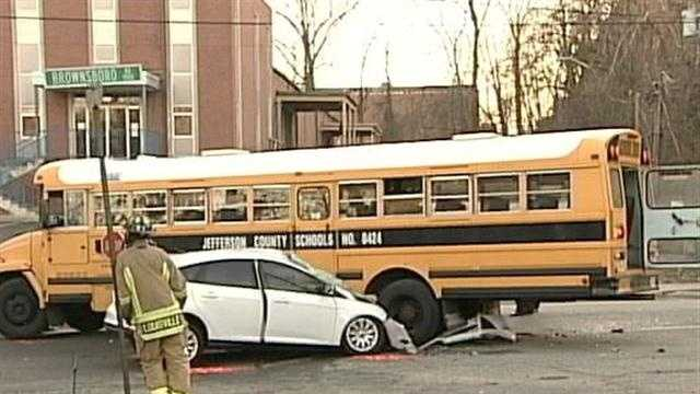 A woman suffers life-threatening injuries after a crash with a Jefferson County Public School bus Monday.