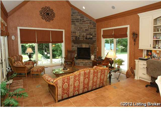 Next to the kitchen is this cozy sitting area, complete with beautiful windows and a brick fireplace.