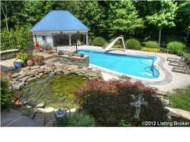The hot tub and waterfall koi pond adds the final touch to this breathtaking enclave.