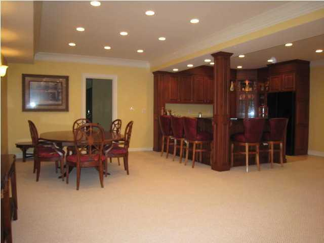 Renovated basement, features a full bar and sitting area.