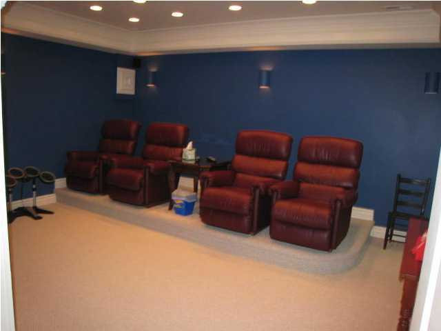 The room also features a media/movie room.