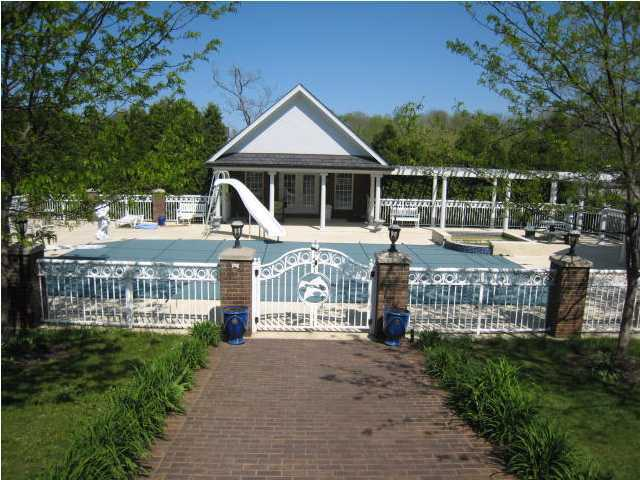 Here, the pool is shown covered but the area also includes a guest home and outdoor jacuzzi.