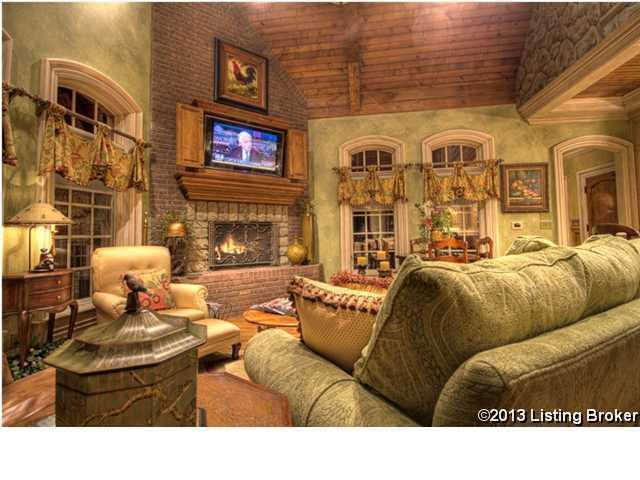 Custom, hanging TV unit above the fireplace.