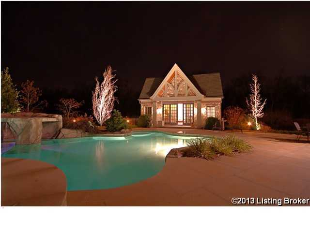 Massive huge featuring a grotto, looks fantastic at night. There is also a guest home on the property.