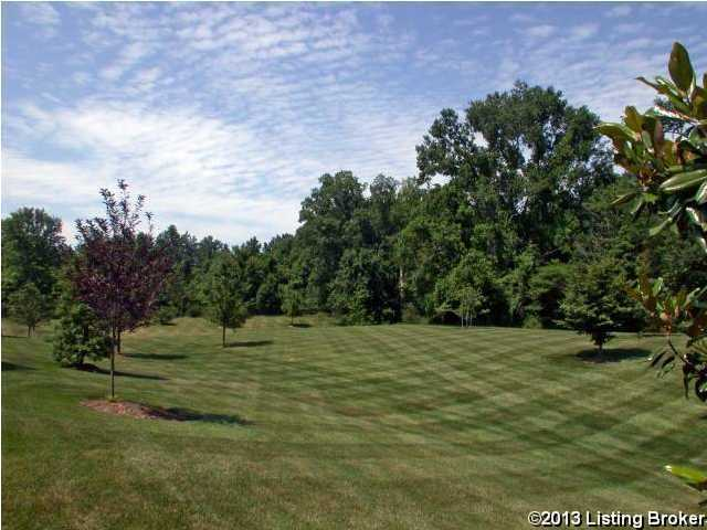 Perfectly manicured lawns on this 5 acre property.
