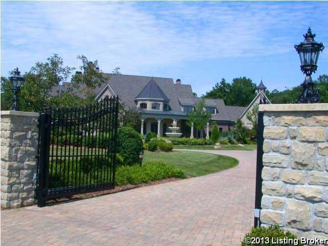Grand, brick driveway greats you at the gate of this beautiful home.