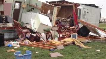Two people, including a 7-year-old boy, were injured overnight when a tornado hit his home in Marion County, Ky.