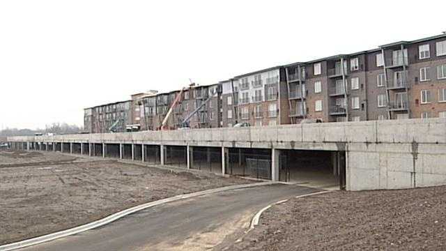 Eight years after its initial plans, the first 80 tenants of Louisville's RiverPark Place are all moved in and developers are continuing to build right along the Ohio River.