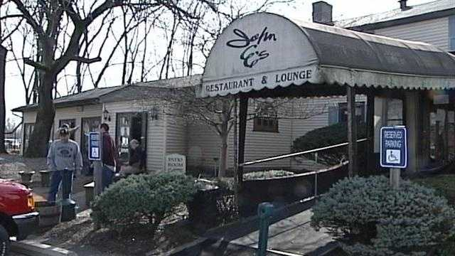 Hundreds packed the now-closed John E's restaurant as it cleaned house at auction.