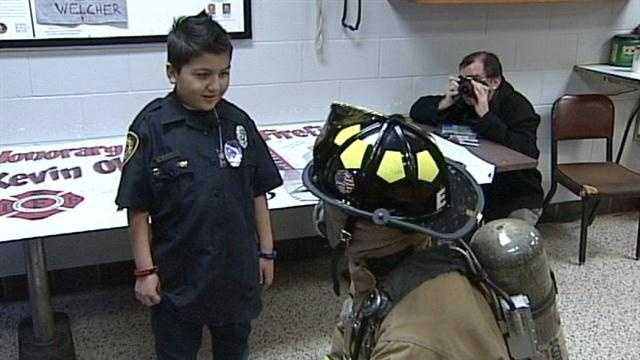 A 9-year-old Louisville boy was honored by the mayor, firefighters, police and EMS for his bravery.