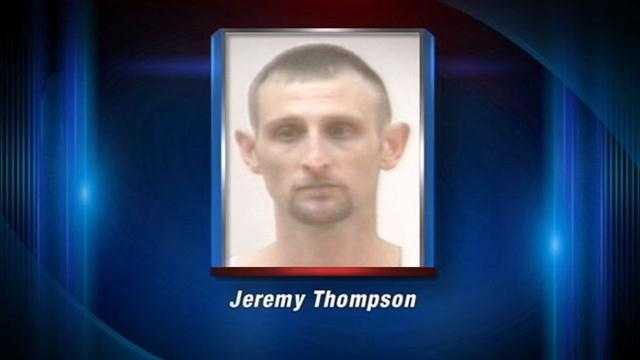 A Jeffersonville man is in jail charged in connection with assaulting two police officers and a child services worker while she was holding his baby.