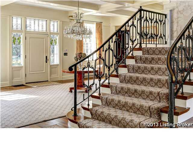 Grand foyer features a beautiful, crystal chandelier.
